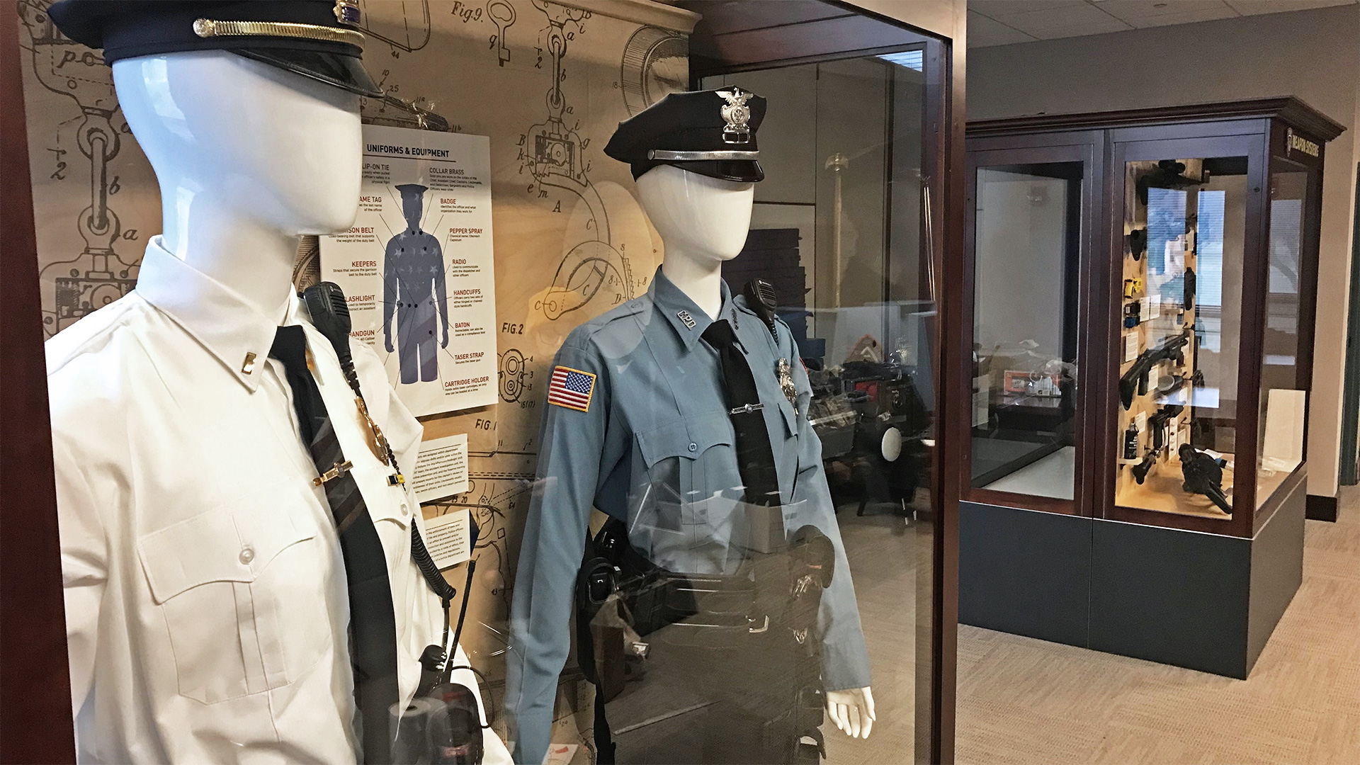 The start of the Cheektowaga PD police history museum includes exhibit design centered around uniforms and equipment, and firearms