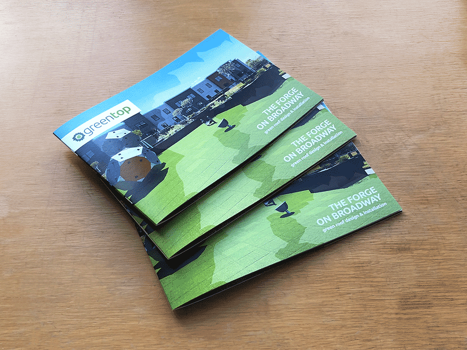 Multiple copies of the Greentop Case Study Booklet displayed, showing the cover design with the otherwisz creative designed greentop logo prominently displayed over the green roof