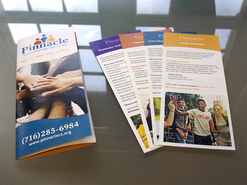 Custom brochure design and four linecards designed by OtherWisz Creative provide helpful information for Pinnacle Community Services' clients