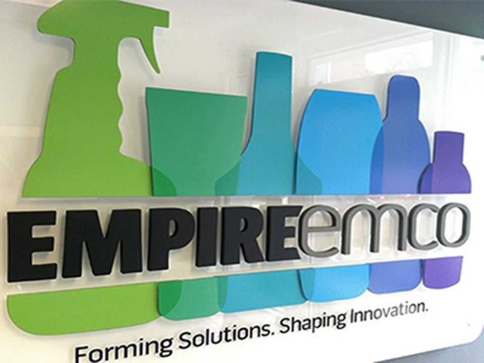 Logo design for Empire Emco installed in an office