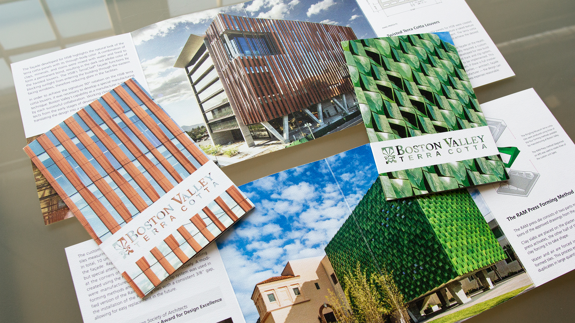 A set of printed case study brochures with a custom sleeve for architectural manufacturer
