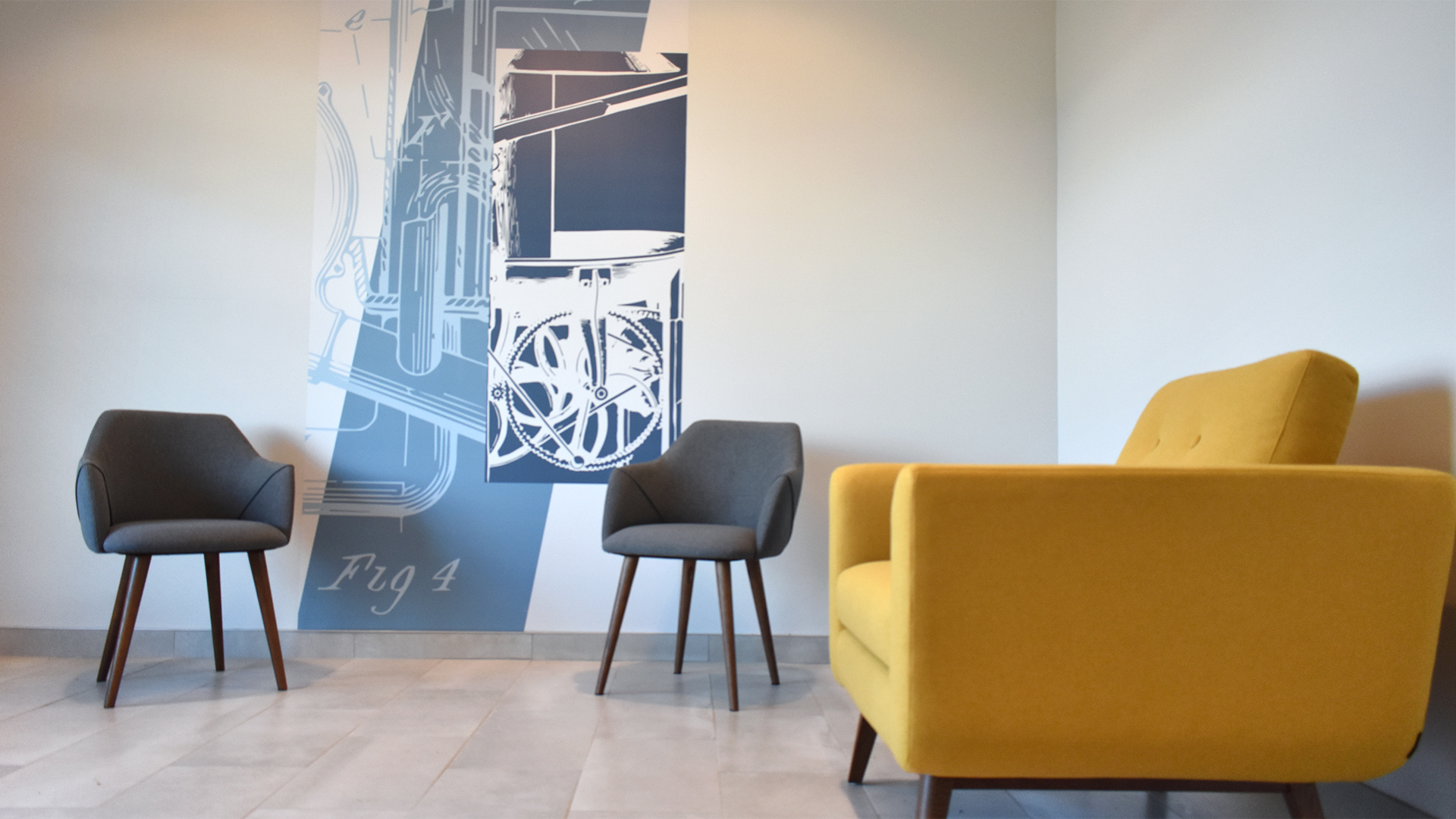 The wall murals and interior design in The Forge Apartment's lounge work together to create a comfortable, yet modern branded space