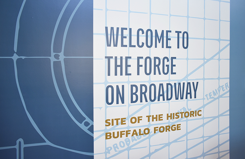 The Forge on Broadway wall graphics designed by OtherWisz Creative using historic materials of the original forge.